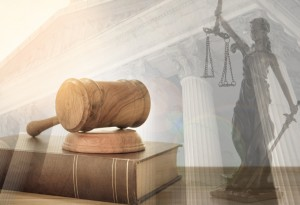 Judge gavel on law books with statue of justice and court government background. concept of justice, legal.